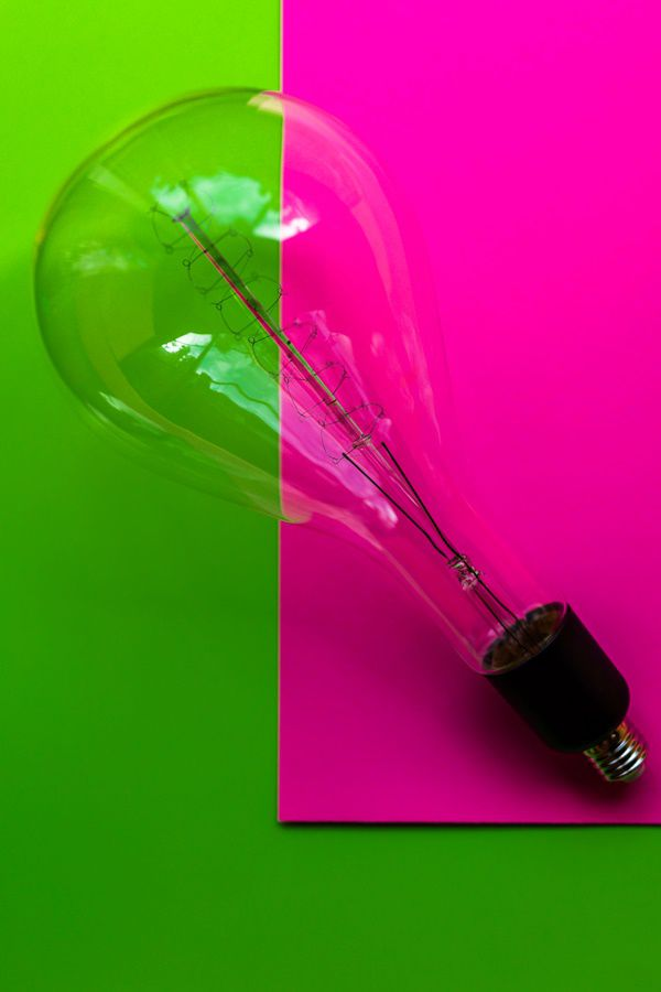 old lightbulb in green and pinck colour cardboard