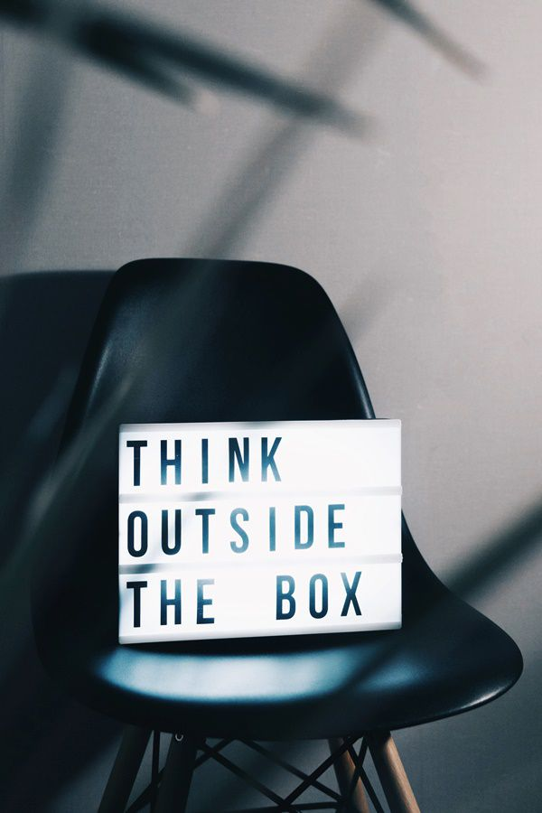 A 'think outside the box' box on a chair