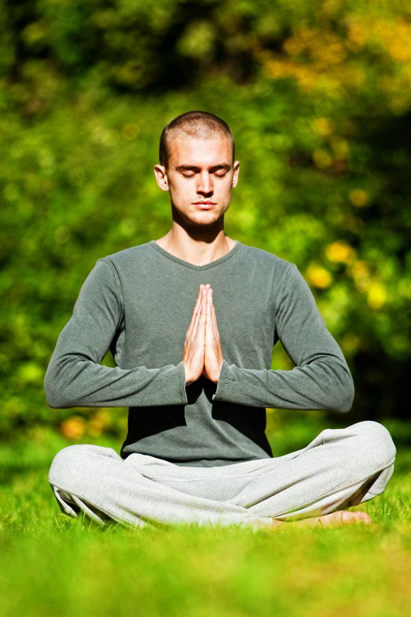 Bald men doing peaceful Yoga