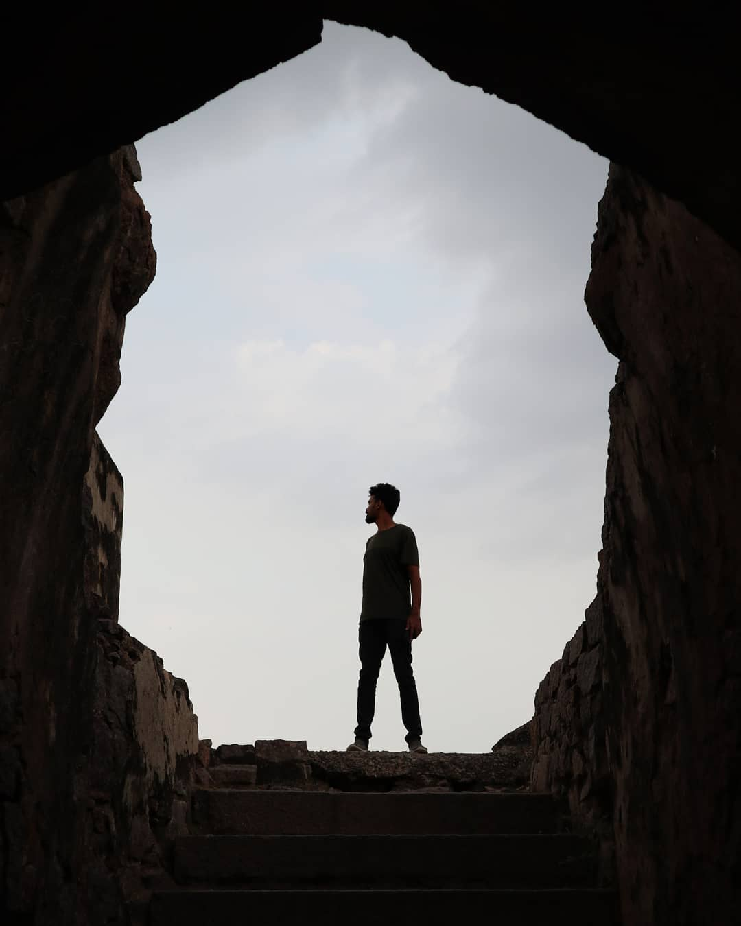 Man infront of cave