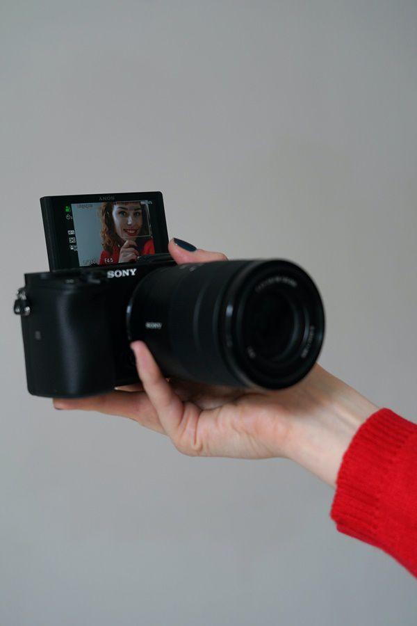 Women holding sony camera